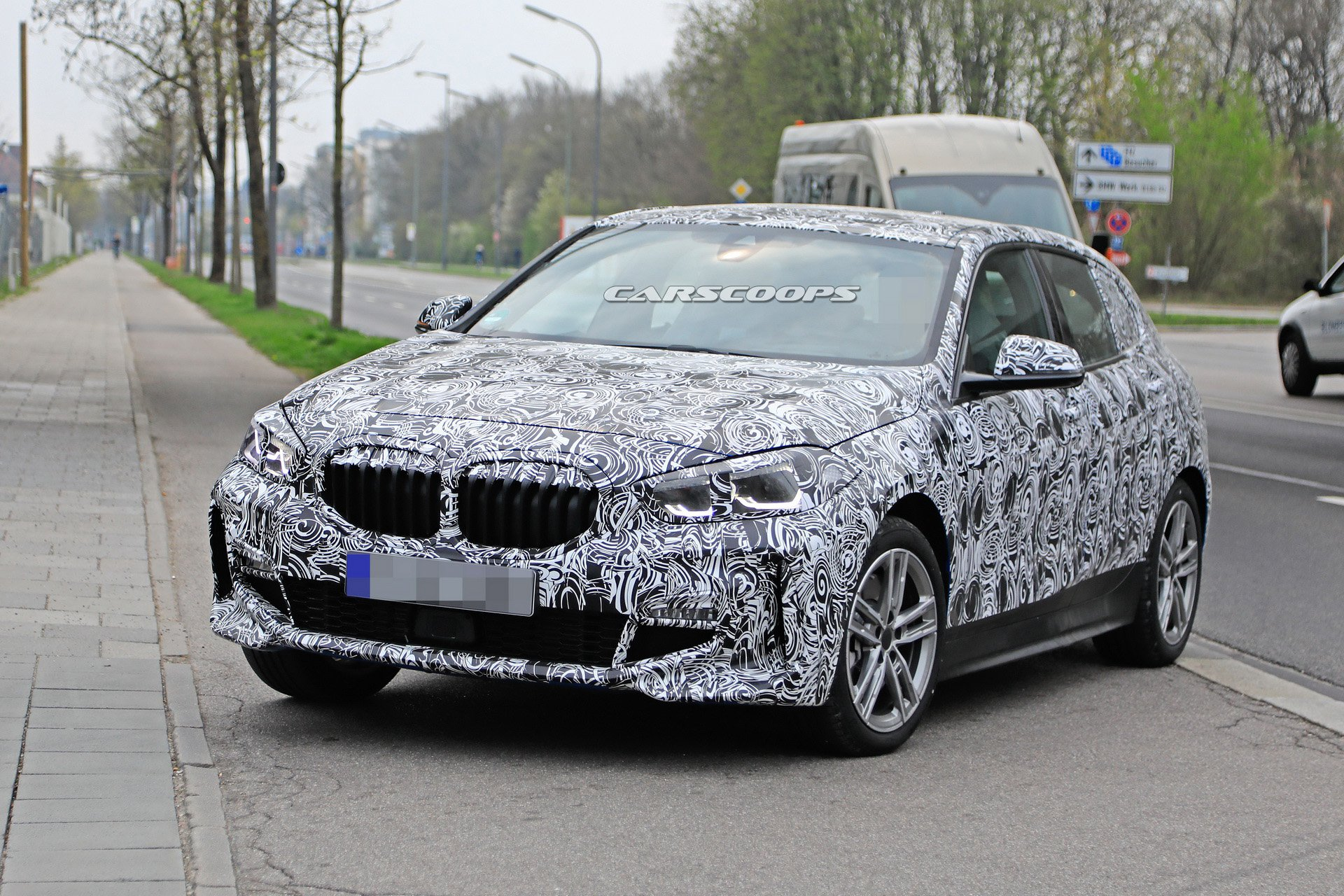 Name:  2ab21077-2020-bmw-1-series-spied-with-less-front-camo-3.jpg Views: 1070 Size:  576.4 KB